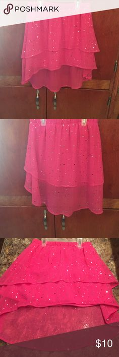 Girls hi-lo pink skirt Skirt size 6x. Skirt is monster high character brand. Skirt is pink with silver sequins. Has been worn once but still in good condition monster high Bottoms Skirts