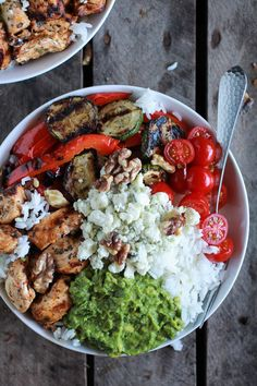 California Chicken, Veggie, Avocado & Rice Bowl - chicken breasts, olive oil, garlic, onion powder, pepper, cayenne pepper, smoked paprika, parsley, basil, jasmine or basmati rice, red pepper, zucchini, avocados, lemon, grape tomatoes, walnuts, & crumbled blue cheese