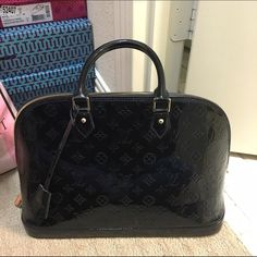 LV Glossy bag! $290 on Ⓜ️ This bag has been collecting dust in my closet for quite some time. It's too beautiful for use so i might as well get rid of it. It's obv not real but VERY good quality. Has a little white mark in the bottom and it dents in a little if the bag is empty. Will sell for $290 on Ⓜ️erc. Just comment below so i can make a listing on there Louis Vuitton Bags