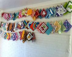 #crochet dishcloths hanging from clotheslines.