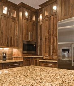 Black walnut shaker style cabinets with waterfall glass display cabinet uppers