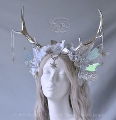 The Silver Antlered Winter Fairy Faun headdress, also available this Tuesday Jan. 10 at 6am PST for $269! Iridescent beads and silver snowflakes dangle from the silvery antler tips, and a single snowflake rests on the forehead. Glitter frosted pale...
