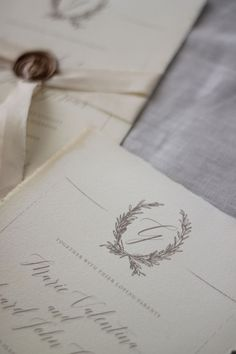 Just My Type wedding invitation and stationery design NZ organic, natural, romantic and vintage suite. Featuring torn edges, calligraphy, tea stain, wax seals, silk ribbon, illustration wreath, wedding logo motif x