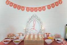 I like a couple different elements of this Bridal Shower decor. The banner, the frames, the ribbons hanging on the wall behind the dessert table.