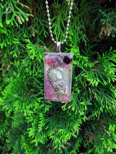 Starry Night Resin Jewery Pendant with vibrant silver, cranberry and raspberry  - Three Demensional wearable art by Terripoppinscrafts. $18.00, via Etsy.