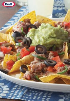 Cheesy Beef Nachos – These are classic nachos with ground beef, Mexican 4 cheese, guacamole, salsa, fresh tomato and jalapeno. An easy game day food you can make in 15 minutes!