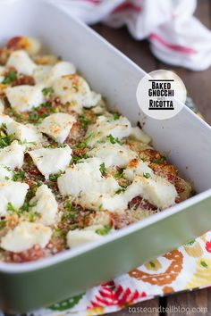 Baked Gnocchi with Ricotta - 1 package gnocchi (16 oz), 1 cup marinara, 3/4 cup ricotta, 1/4 cup grated parmesan, chopped parsley