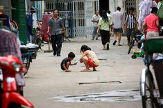 Kids playing in the streets of Phnom Penh, Cambodia, via Flickr.