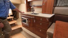 The Formula 370 Super Sport's galley is small but well suited to this type of boat. The convection microwave is mounted below, amidst perfectly finished cabinetry. See more of the 370 Super Sport at http://www.formulaboats.com/models/models.aspx?id=1573872&class=3.
