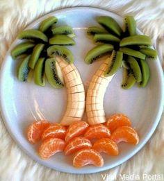 Banana and kiwi palm trees resting on oranges