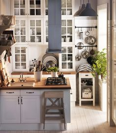 Kitchen - I think it's from the Ikea catalog. Love the perfect use of small space, yet it still feels airy & open.