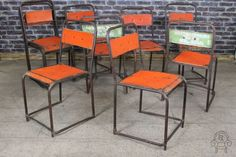 Stacking chairs in a variety of colours original vintage #industrial #stylish #orange