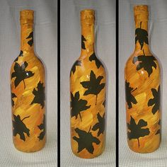 """AUTUMN LEAVES ON PAINTED BOTTLE    Yello!    This is an entirely hand painted and individually design art on curvy glass bottle, rather tall as well! A very unique and special piece.    Autumn Leaves on Painted Bottle    Height, you ask? 32 cm [12.6""""]  Circumference, you tout?  27 cm [10.6""""]    €30"""