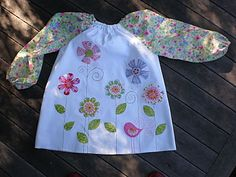 FREE PATTERN Art smock for kids with darling appliques (rocket ship for boys).  Pattern needs to be printed full size at a copy shop.
