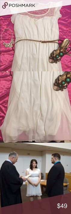 Beautiful Torrid Cream colored chiffon dress I wore this once when I got married it was only worn a few hours , comes with belt.  Beautiful lace detailing , chiffon , light and flowing. Torrid size 2 ( equivalent to 18-20 or a 2x) torrid Dresses Midi