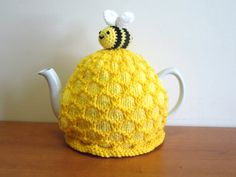 This is a lovely hand made knitted beehive tea cosy that fits a standard 4-6 cup (2-pint uk) teapot. 40 fl oz. Bee hive tea cosy  The tea cosy has a bee on top, and would be lovely gift for a gardener or beekeeper.  The honeycomb relief is knitted in slightly darker wool, which highlights the honeycomb affect.  It is knitted in double knit wool, doubled, which is fairly stretchy, so fits well over most teapots  it is very thick and soft, so keeps the tea nice and warm.  This cute bee and…