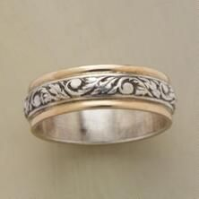 The tendrils of this silver & gold vine band ring will wrap around your finger and your heart.