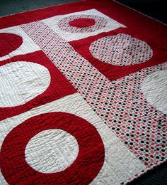 Can't go wrong with bold red and white. This one is from themodernquiltguild.com