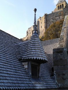 Mont Saint Michel, Normandy - France - construction on the island started in the 8th century AD. Here, shingle roofing on a house.