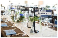 bud vases, green, light blue, wedding, street sign table names // Events by Satra // The Cutting Garden at Flora Grubb // Susannah Gill Photography