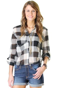 Lightweight gauze type plaid top with a big pocket and button up closure. Laken is wearing a size Small.