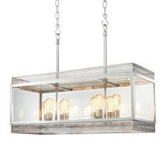 The Roma Chandelier from Eichholtz blends industrial and contemporary styles expertly to make for a beautiful, cage-like piece made from steel and glass. Stunning!