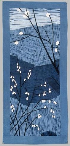 Hand dyed shibori cottons in indigo; appliqued by hand, pieced and quilted by hand and by machine. Private Collection, Athens, OH  Inspired by harbingers of spring, east and west, plum blossoms  pussy willows.