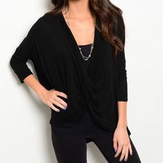 Black Crotchet Back Top Black half sleeve top with a cross cross front. The back is a gorgeous crotchet cover. Made of a cotton blend. Size S,M,L Tops Tees - Long Sleeve