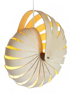 Make a nautilus shell using pieces of paper and a brad for Ocean Commotion - similar to this lamp...