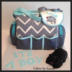 Baby Shower - Chevron diaper bag. They love camping so the bib is little camper and black bear made from fondant.