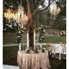 We love this sweetheart table setting Saddlerock Ranch using our charming French Doors as a background! Those chandeliers in the trees really make this outdoor wedding feel extra intimate and romantic. | Pretty Vintage Rentals - California weddings