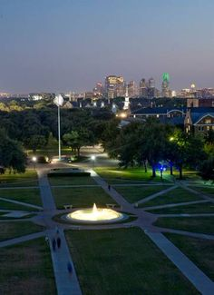 SMU Southern Methodist University Mustangs - View of Dallas skyline from SMU campus at dusk.