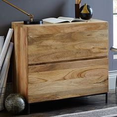 """Rustic Modular Lateral File #westelmSeamless, storage-friendly style. Crafted from solid mango wood and lofted on airy steel legs, our Rustic Modular Lateral File features generously sized drawers for storing letter and legal files, or for stashing away books, magazines and other office supplies. 32""""w x 18.5""""d x 30""""h. Solid mango wood; metal frame with a Black finish. Natural variations in the wood grain and coloring are to be expected. Two drawers open on metal glides. Made in India."""