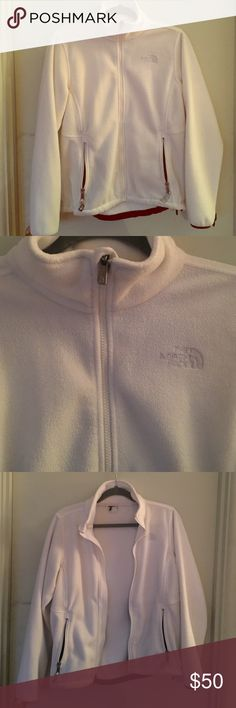 Womens North Face jacket Women's North Face jacket made with plush silken fleece. This jacket is white and has two zip up pockets and the front completely zips up or down. This cozy jacket will keep you warm even on those cold days. North Face Jackets & Coats