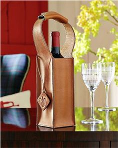 Smart and stylish, the Williams-Sonoma Home saddle-hued leather tote is great for gift-wrapping wine, and will be used again and again for toting bottles to parties and picnics. Finished with top…