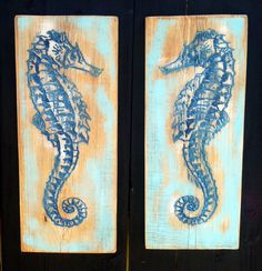 """Two Large SEAHORSES Carved in Two Pieces of Florida Cypress. Two Mirror Image SEAHORSES Carved in Two Rustic Pieces of Cypress by Florida Artist, Carl McCoy. V-Carved, painted with enamel paint and stained for interior use. They would look great flanking a sofa, bed, buffet, etc. They each measure approximately 10"""" wide by 24"""" tall. I can seal with spar varnish for exterior use on request."""