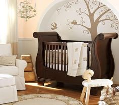 A dash of fairy tale style can be added to a space with a leafy chandelier and golden artwork, such as the tree mural beside the crib. In fact, when it comes to mural locations, a crib-side display is a popular choice, as it ensures that your little one can fully enjoy the image.