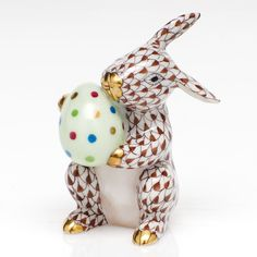 Herend Hand Painted Porcelain Figurine of Easter Bunny w White Egg Covered in Colorful Dots, Bunny in Chocolate Fishnet w Gold Accents.
