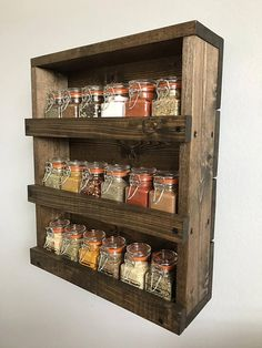 Spice up your kitchen with our simple and rustic style solid wood spice rack, handmade, designed and entirely hand finished. Keep your spices organized and within easy reach with lots of room for your favorite ones with the 3 shelves. Youre spices will be held securely by the railing.  It will look amazing and add a warm rustic touch, whether hung on the wall or free standing on the counter. Just choose from the options offered if you want the spice rack free standing or with attached…