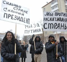 """Photo by Alexei Vitvitskiy from pro-Putin meeting in Moscow, Russia at 23.02.2012. Posters read: """"Strong country needs strong president"""", """"We vote for Putin"""", """"Against swinging the Country"""""""