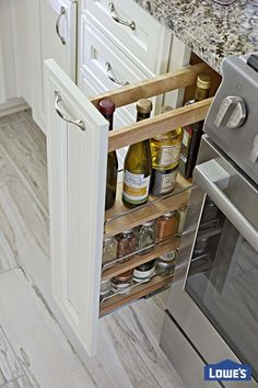 A narrow pullout spice rack by the range offers easy access to frequently used oils and herbs. Home Kitchens, Kitchen Remodel, Kitchen Design, Sweet Home, Kitchen Inspirations, Kitchen Decor, Home Remodeling, New Kitchen, Home Decor