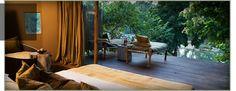 Tented suites at the Taj Banjaar Tola, set along the Banjaar River in Kanha National Park, India.