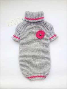 Hand knitted sweater for small dog (girl) made from acrylic and 15% wool. Easy on, easy off and absolutely soft and cozy. COLOR OF THIS SWEATER IS LIGHT GRAY WITH FUCHSIA FLOWER. SIZE: BACK LENGTH - 12 / 31 cm NECK GIRTH: +/- 9,5 / 24 cm CHEST GIRTH: +/- 14 / 36 cm This sweater is good