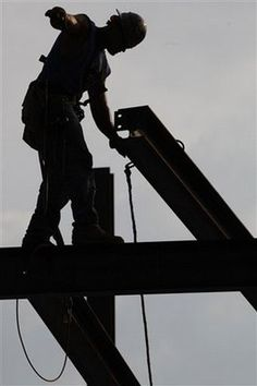 Ironworker...my dad did it for 32 years...can't believe how brave he was.
