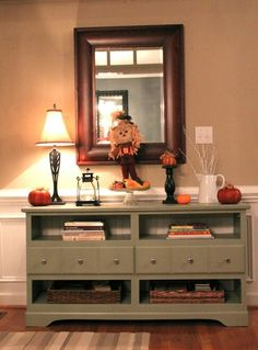 A foyer stand out of a re-purposed dresser.