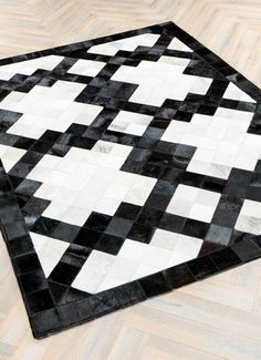 Versailles is handcrafted from individual segments of cowhide forming a magnificent black & white pattern. Designed in England & Ethically produced of recycled cowhide from the luxury leather goods industry. Modern Carpet, Modern Rugs, Modern Homes, Cow Hide Rug, Cow Rug, Geometric Pattern Design, Carpet Design, Floor Design, Rug Sale