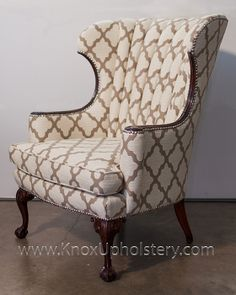 beautiful wingback chair ...love the nail-head details