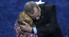 Retired General John Allen hugs a woman on stage after speaking in support of Hillary Clinton as commander-in-chief. (Getty)