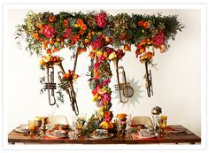 wedding decor with flowers and brass instruments.  Lovely.