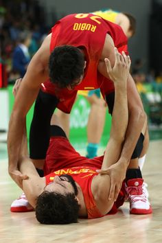 Sergio Llull of Spain and Ricky Rubio of Spain celebrate winning the Men's…